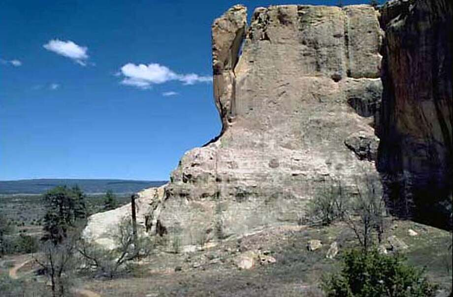 El Morro is a 200-foot-tall white sandstone bluff that was home to a large Anasazi pueblo. El Morro National Monument on 4/6/05. / National Park Service