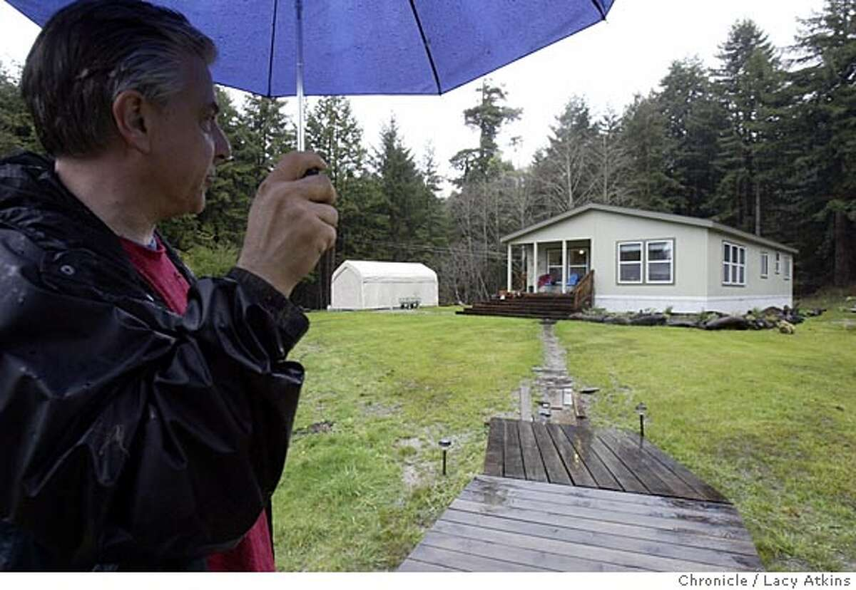 Tom Abate ouside his second home in Eureka Feb.2,27,05. A first person from Tom Abate guiding wannabe second home builders told through the eyes of yours truly, who last summer financed and engineered the construction of a three-bedroom, two bath manufactured home on 5 acres of Redwoods outside the college town of Eureka, Sunday Feb.27,2005. Photographer Lacy Atkins