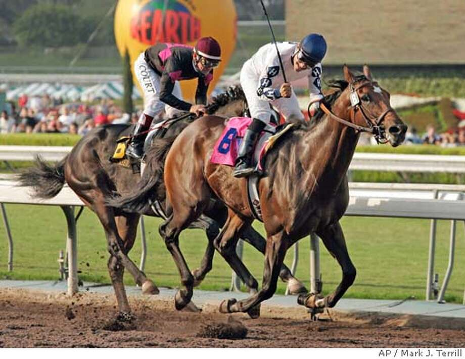 Corey Nakatan,i atop Cozy Guy, celebrates as he wins the $250,000 California Cup Classic followed by Jon Court, atop Lava Man, Saturday, Oct. 16, 2004, in Arcadia, Calif. (AP Photo/Mark J. Terrill) Sports#Sports#Chronicle#10/17/2004#ALL#5star##0422416995 Photo: MARK J. TERRILL