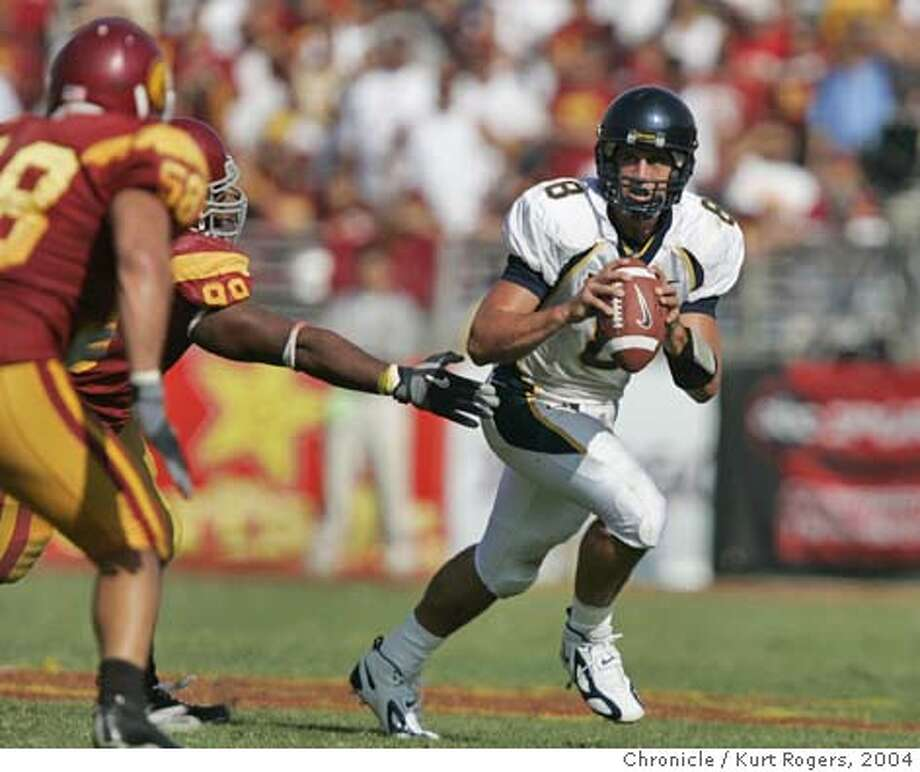 Aaron Rodgers looks down field in the 4th The University of California Berkeley Golden Bears vs the University of Southern California Trojans at the Los Angeles Memorial Coliseum.  CAL_530_kr.JPG 10/9/04 in Los Angeles,CA.  KURT ROGERS/THE CHRONICLE Ran on: 10-10-2004  Aaron Rodgers' great day ended with three incompletions and a sack near USC's goal line. Ran on: 10-10-2004  Aaron Rodgers' great day ended with three incompletions and a sack near USC's goal line. MANDATORY CREDIT FOR PHOTOG AND SF CHRONICLE/ -MAGS OUT Photo: KURT ROGERS