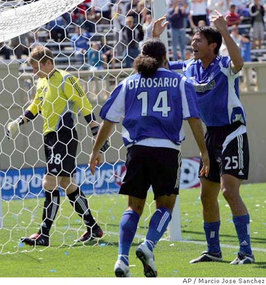 San Jose Earthquakes' Brian Ching, right, and Dwayne De Rosario celebrate after Ching scored a goal past Chivas USA goalie Brad Guzan, left, during the second half in San Jose, Calif., Saturday, April, 9, 2005. (AP Photo/Marcio Jose Sanchez) Photo: MARCIO JOSE SANCHEZ