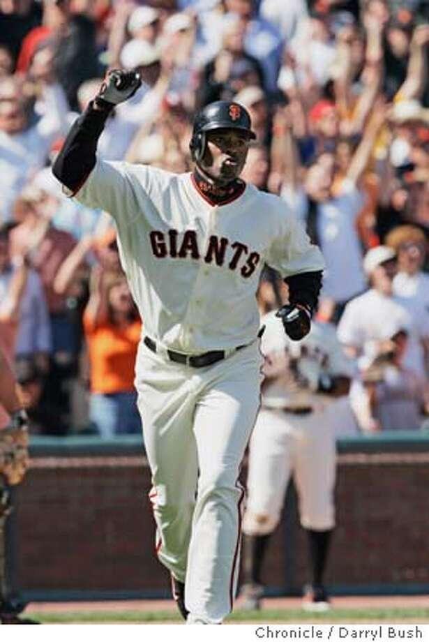 San Francisco Giants Michael Tucker celebrates after hitting a grand slam home run in the eighth inning vs. Colorado Rockies at SBC Park.  Event on 4/9/05 in San Francisco.  Darryl Bush / The Chronicle Photo: Darryl Bush