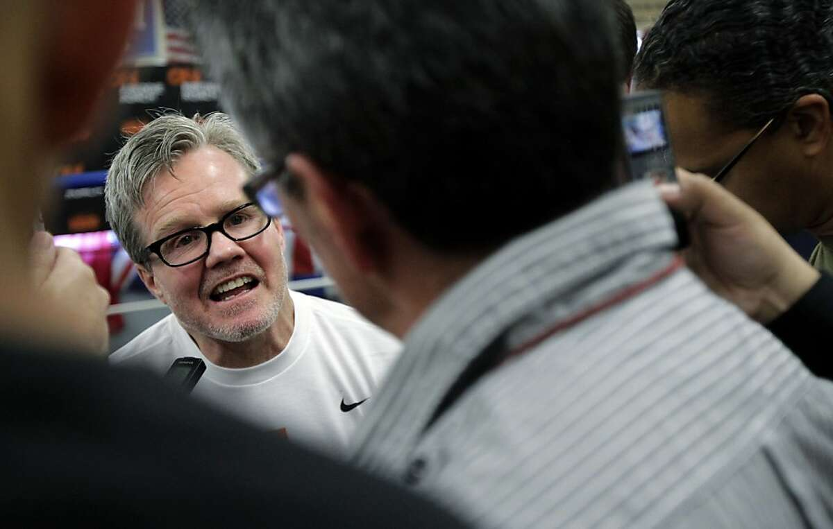In this Friday, Jan. 13, 2012, photo, boxing trainer Freddie Roach speaks with reporters at the Wild Card Boxing Club in Los Angeles. HBO's new documentary series about Roach will surprise many fans of the network's sports programming. Producers Peter Berg and Jim Lampley dispensed with narration or story lines, taking a verite approach as their cameras follow Manny Pacquiao's trainer through his eventful life. (AP Photo/Jae C. Hong)