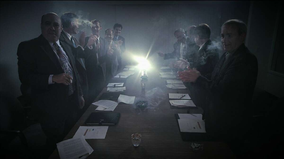 Tobacco company executives applaud in a re-enactment from ADDICTION INCORPORATED.