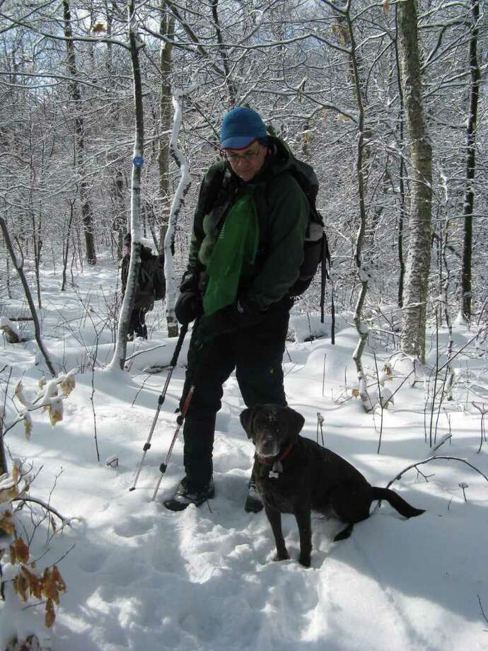 (Photo by Gillian Scott/Times Union) Local author Alan Via and his dog, Bookah, along the Silver Hollow trail in the Catskills last weekend (Jan. 14, 2012)