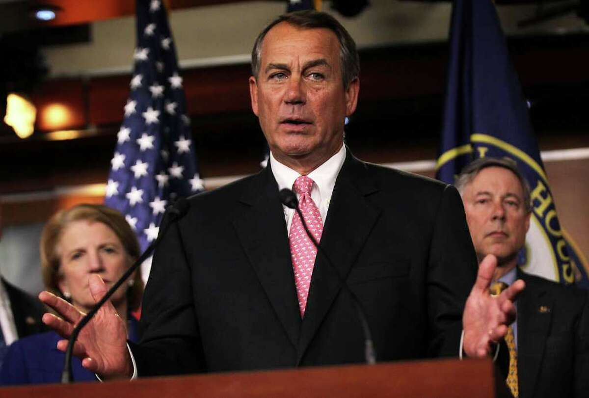 WASHINGTON, DC - JANUARY 18: U.S. Speaker of the House Rep. John Boehner (R-OH) (C) speaks as Rep. Shelley Moore Capito (R-WV) (L) and Rep. Fred Upton (R-MI) (R) look on during a news conference January 18, 2012 on Capitol Hill in Washington, DC. House Republicans held a news conference to respond to Obama Administrationâ?TMs decision on rejecting the controversial Keystone XL pipeline project. (Photo by Alex Wong/Getty Images)