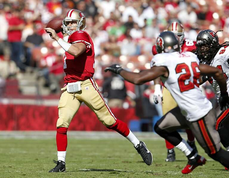 San Francisco 49ers quarterback Alex Smith throws the ball for a first down against the Tampa Bay Bu