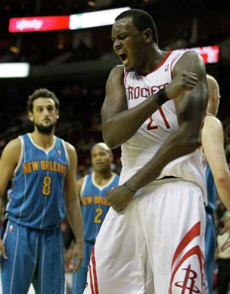 Houston Rockets' Samuel Dalembert celebrates his basket over New Orleans Hornets' during the final seconds of overtime NBA game at Toyota Center Thursday, Jan. 19, 2012, in Houston.  His score put the Rocket over 90-88 and was the game winner. Photo: Melissa Phillip, Houston Chronicle / © 2011 Houston Chronicle