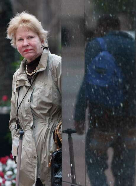 Diane Weathersbee waits for the bus Thursday on Lamar Street downtown, shivering in a light jacket. To pick Friday's wardrobe, see forecast, page B10. Photo: Cody Duty / © 2011 Houston Chronicle