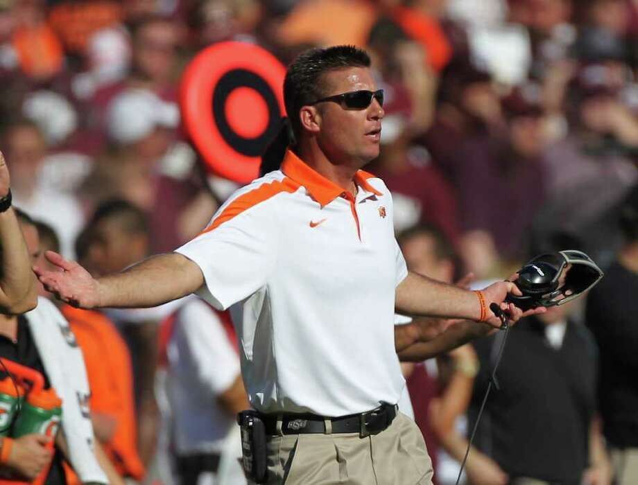 Oklahoma State head coach Mike Gundy yells at a referee in the third quarter of a NCAA football game against Texas A&M, Saturday, Sept. 24, 2011, in Kyle Field in College Station. Oklahoma State won 30-29. Photo: Nick De La Torre, Houston Chronicle / © 2011 Houston Chronicle