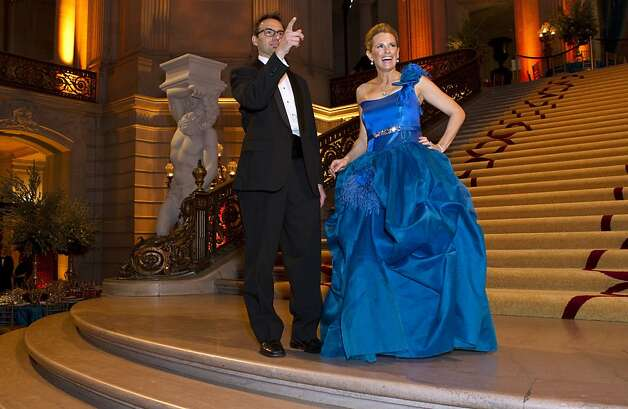 Andrew Trader (left) and Marie Hurabiell, chairwoman for the San Francisco Ballet Opening Night Gala, greet friends before the start of the gala at City Hall in San Francisco, Calif., on Thursday, January 19, 2012.  Hurabiell's dress was made in Barcelona, Spain and flown over in it's own plane seat. Photo: Laura Morton, Special To The Chronicle