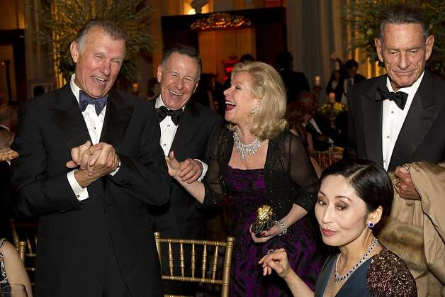 Richard Kovacevich, Carl Pascarella, Dede Wilsey, Yurie Pascarella and Charles de Guigne (left to right) share a laugh while sitting down to dinner during the San Francisco Ballet Opening Night Gala at City Hall in San Francisco, Calif., on Thursday, January 19, 2012. Photo: Laura Morton, Special To The Chronicle