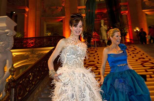Stephanie Ejabat (left) and gala chairwoman Marie Hurabiell walk down the steps of City Hall before the start of the San Francisco Ballet Opening Night Gala in San Francisco, Calif., on Thursday, January 19, 2012.  Ejabat wore a gown by Marchesa and Hurabiell a gown by Frans Baviera, a designer from Barcelona. Photo: Laura Morton, Special To The Chronicle