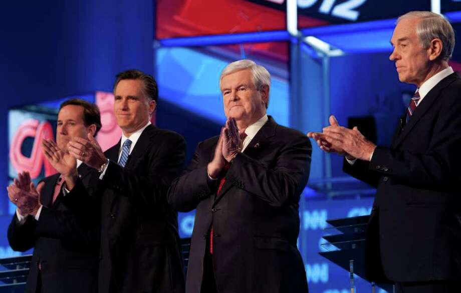 Taking the stage for their debate Thursday night in North Charleston, S.C., were Rick Santorum, Mitt Romney, Newt Gingrich and Ron Paul. Photo: PAUL J. RICHARDS / AFP