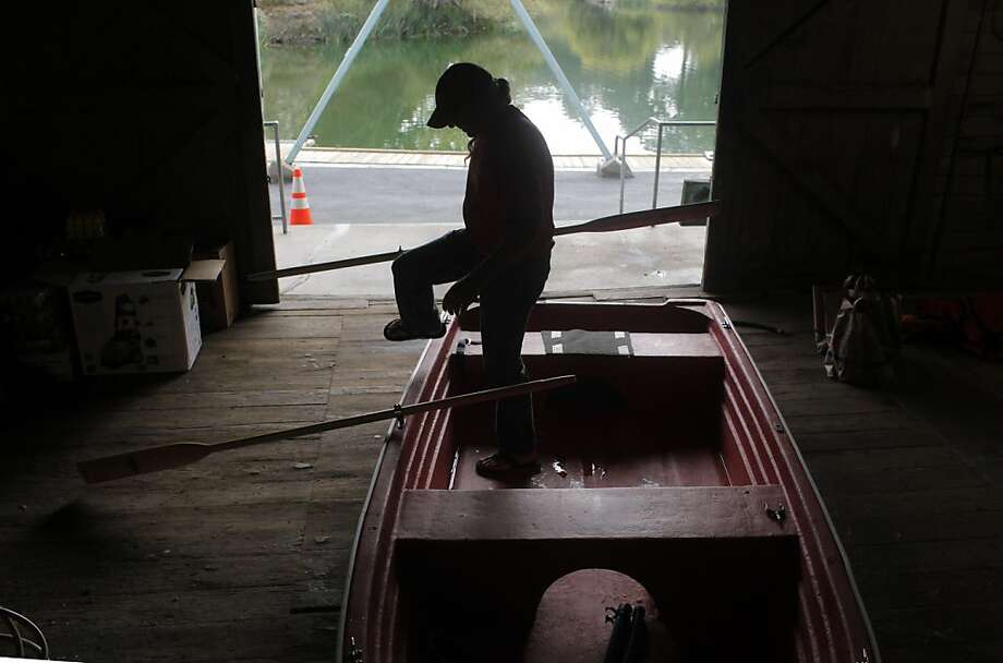 Craig Shaw put together the new boats at Stow Lake in Golden Gate Park, Tuesday October 11, 2011, in San Francisco, Calif. The new operators, the Ortega Family Enterprise are opening the boat rental and food concession of Wednesday. Photo: Lacy Atkins, The Chronicle