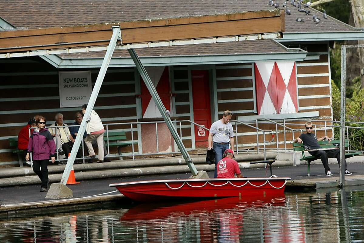 Andy Bloomfield and Craig Shaw put together a new boat at Stow Lake Boathouse in Golden Gate Park, Tuesday October 11, 2011, in San Francisco, Calif. The ownership changeover at the boathouse took a year of wrangling.