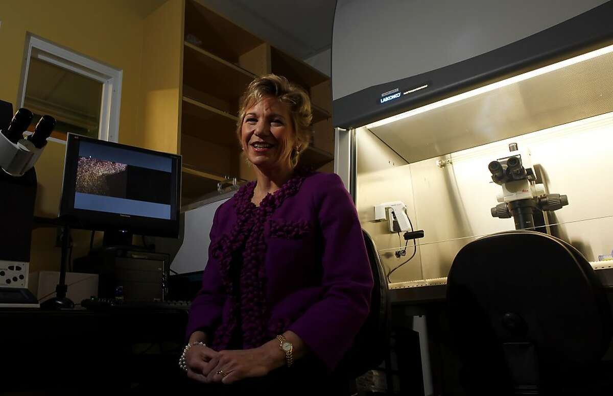 UCSF Chancellor Susan Desmond-Hellmann poses in a lab, Monday Jan.4, 2010, in San Francisco, Calif.