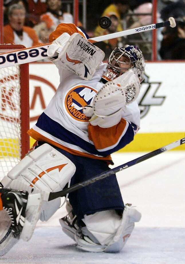 New York Islanders goalie Evgeni Nabokov, of Russia, deflects a puck during the second period of an NHL hockey game against the Philadelphia Flyers, Thursday, Jan. 19, 2012, in Philadelphia. The Islanders won 4-1. (AP Photo/Tom Mihalek) Photo: Tom Mihalek, Associated Press