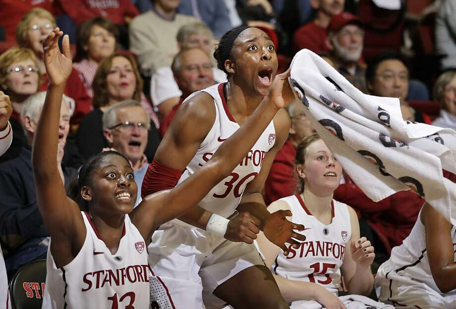 Stanford forwards Nnemkadi Ogwumike (30) and Chiney Ogwumike (13) celebrate late in the second half of an NCAA college basketball game against Washington State in Stanford, Calif., Thursday, Jan. 19, 2012. Stanford defeated Washington State 75-41. (AP Photo/Paul Sakuma) Photo: Paul Sakuma, Associated Press