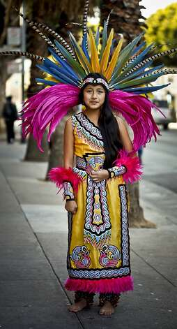 Eleven-year-old Xochiquetzalli Pena started dancing La Danza Azteca at age 3. Photo: Russell Yip, The Chronicle