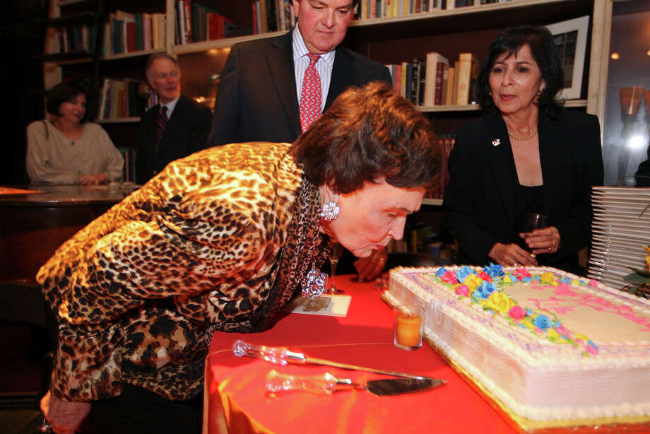 Former Mayor Lila Cockrell blows out a candle during her 90th birthday reception held on Jan. 19, 2012 at the Tobin Estate. Photo: Edward A. Ornelas/Express-News / SAN ANTONIO EXPRESS-NEWS (NFS)