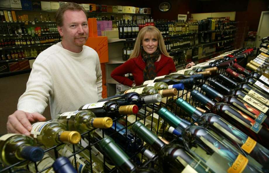 (L-R) Chris Dortenzio and Anna Reis are the co-owners of Premier Wine and Spirits, a new liquor store on Tunxis Hill Road. Photo: Phil Noel / Connecticut Post
