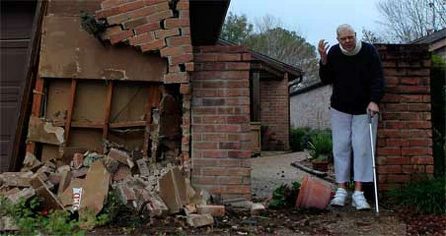 Robert Liska stands outside his Innwood Forrest home on the  7700 block of Green Lawn Dr., where a car crashed into his home.