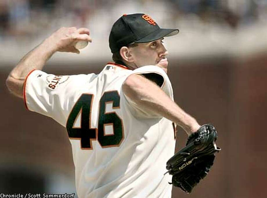 Giant's pitcher Kirk Reuter lets go with a pitch in the 8th inning against the Colorado Rockies. The Giants shut out the Rockies 4-0, behind Reuter and the bullpen.. SF CHRONICLE PHOTO BY SCOTT SOMMERDORF Photo: Scs