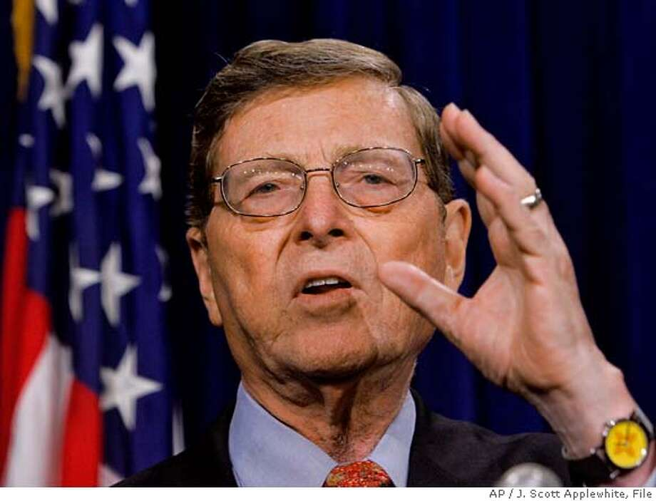 ** FILE ** Sen. Pete Domenici, R-N.M., talks to reporters on Capitol Hill in Washington in this July 29, 2005 file photo. Domenici acknowledged Sunday that he called a federal prosecutor to ask about a criminal investigation, but insisted he never pressured nor threatened his state's U.S. attorney. (AP Photo/J. Scott Applewhite, File) A JULY 29, 2005 FILE PHOTO Photo: J. SCOTT APPLEWHITE