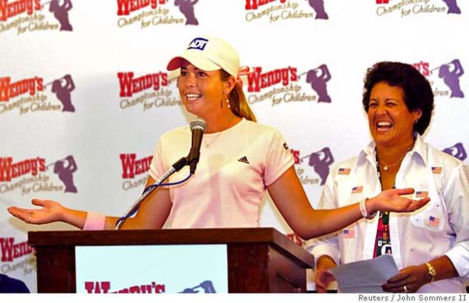 LPGA Tour rookie Paula Creamer (L) speaks to the media as 2005 Solheim Cup Captain Nancy Lopez looks on during a press conference at Tartan Fields Golf Club after the final round of the 2005 Wendy's Championship for Children in Dublin, Ohio, August 28, 2005. Lopez announced Wendy Ward and Beth Daniel as her captain's picks. REUTERS/John Sommers II 0 Photo: JOHN SOMMERS II