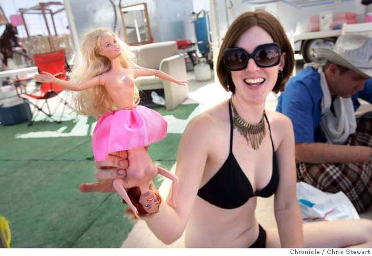 Laura Kingston, 27, of Oakland shows off her newly created bi-chested Barbie doll at the Barbie Death Camp and Wine Bistro on the playa at Burning Man 2005, Tuesday, August 30, 2005 in the Black Rock desert. burnman2005 Chris Stewart / The Chronicle