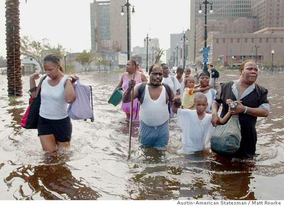 08/30/05 Matt Rourke/AUSTIN AMERICAN-STATESMAN  People move down Canal St. in New Orleans, Louisiana in the aftermath of Hurricane Katrina looking to be evacuated on Tuesday August 30, 2005. Photo: Matt Rourke/AMERICAN-STATESMAN