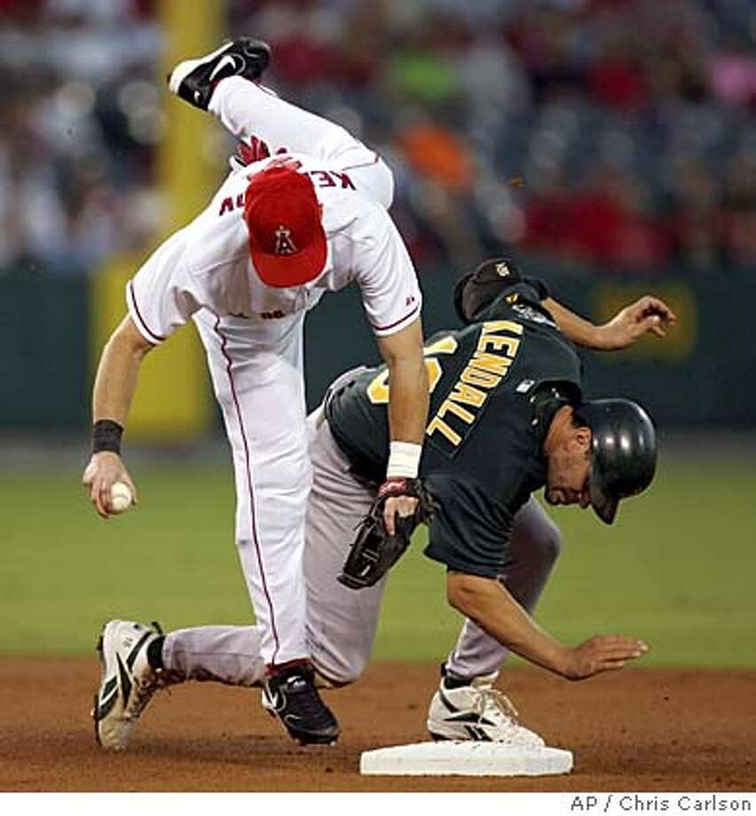 Los Angeles Angels Adam Kennedy falls over Oakland Athletics' Jason Kendall after Kendall broke up a double play during the first inning Tuesday, Aug. 30, 2005, in Anaheim, Calif. (AP Photo/Chris Carlson) Photo: CHRIS CARLSON