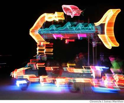An art car cruises the esplanade on the Playa during Burning Man 2005. Photo: Jim Merithew