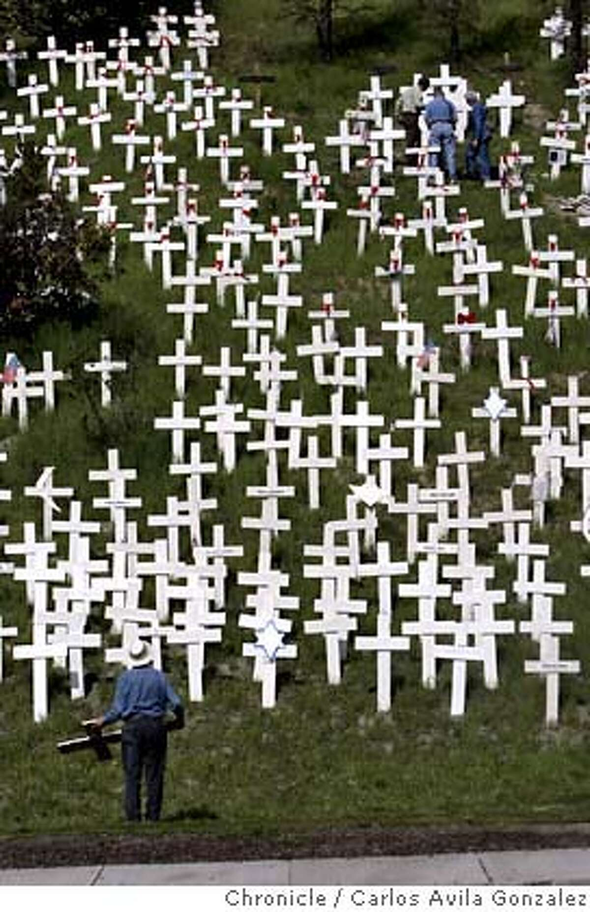 CROSSES05_010_CAG.JPG Volunteers added about 200 new crosses to the controversial Iraq War memorial in Lafayette, Ca., on Sunday, March 4, 2007, enough to represent each of the 3,161 soldiers killed in Iraq since the start of the war. The group, opposed to the war in Iraq, has expanded the stark display overlooking the Lafayette BART station over the past several weeks � gathering in cold weather and at times staging candlelight vigils. Several said blanketing this green hillside with a sea of crosses has reinvigorated their sense of civic activism to a level they haven�t experienced not seen since the Vietnam War. Photo by Carlos Avila Gonzalez/The San Francisco Chronicle Photo taken on 3/4/07, in Lafayette, Ca, USA. **All names cq (source) MANDATORY CREDIT FOR PHOTOG AND SAN FRANCISCO CHRONICLE/NO SALES-MAGS OUT