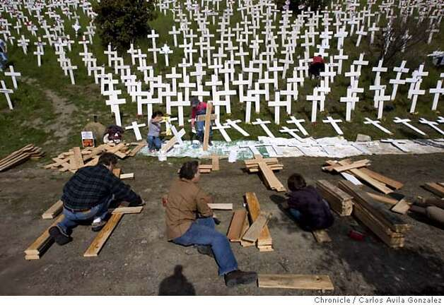 Volunteers added about 200 new crosses to the controversial Iraq War memorial in Lafayette, Ca., on Sunday, March 4, 2007, enough to represent each of the 3,161 soldiers killed in Iraq since the start of the war.  The group, opposed to the war in Iraq, has expanded the stark display overlooking the Lafayette BART station over the past several weeks � gathering in cold weather and at times staging candlelight vigils. Several said blanketing this green hillside with a sea of crosses has reinvigorated their sense of civic activism to a level they haven�t experienced not seen since the Vietnam War.  Photo by Carlos Avila Gonzalez/The San Francisco Chronicle  Photo taken on 3/4/07, in Lafayette, Ca, USA.  **All names cq (source) Photo: Carlos Avila Gonzalez