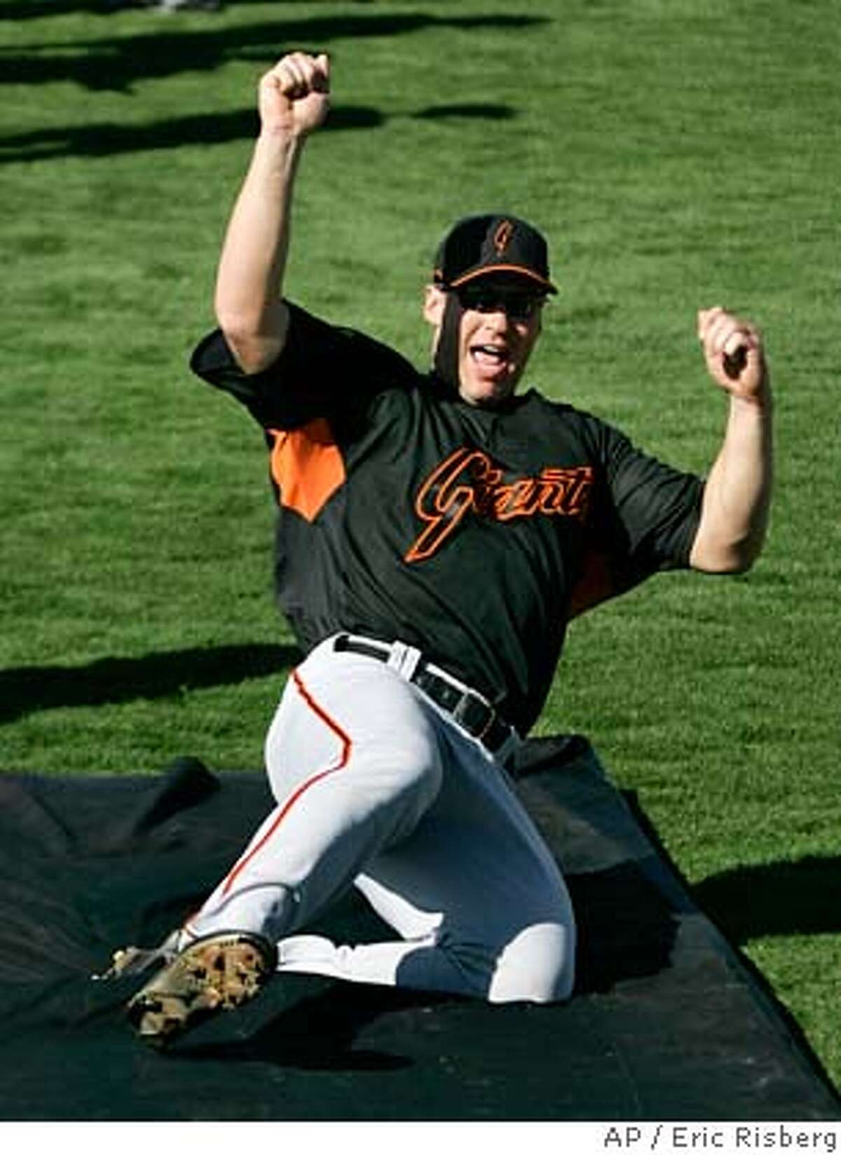 San Francisco Giants outfielder Todd Linden goes sliding onto a mat in the outfield during an exercise at their spring training baseball workout in Scottsdale, Ariz., Monday, Feb. 26, 2007. (AP Photo/Eric Risberg)
