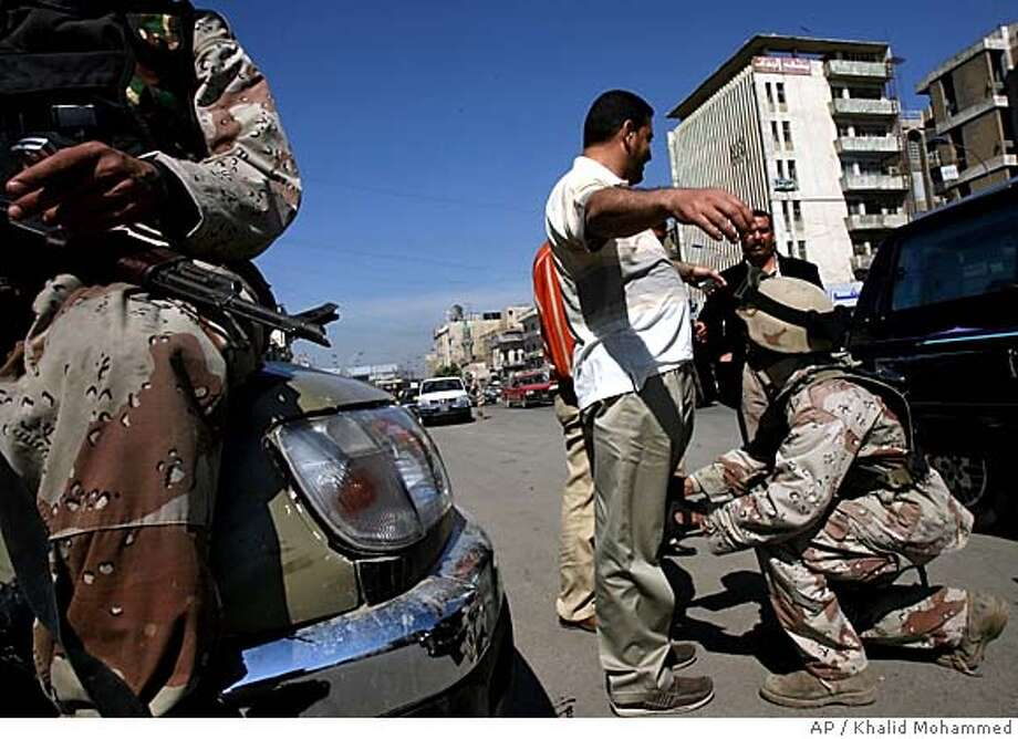 An Iraqi army soldier searches a driver at a vehicle checkpoint in Baghdad, Iraq, Sunday, March 4, 2007. Hundreds of U.S. soldiers entered the Shiite stronghold of Sadr City on Sunday in the first major push into the area since an American-led security sweep began last month around Baghdad. (AP Photo/Khalid Mohammed) Photo: KHALID MOHAMMED