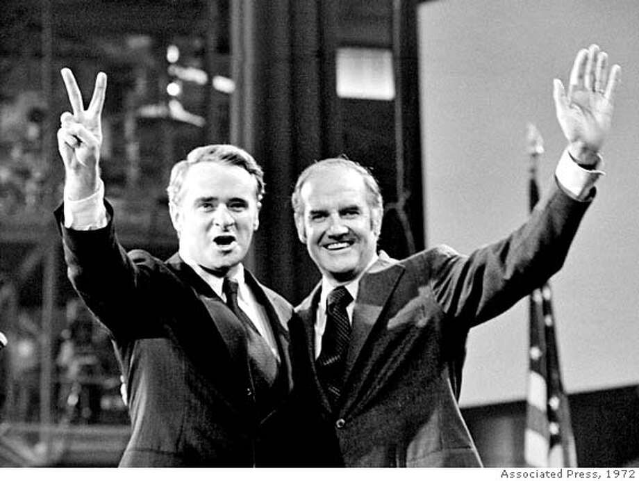 ** FILE ** Then- U.S. Sen. Thomas F. Eagleton, left, and then-Sen. George S. McGovern, the presidential candidate, stand before the delegates to the Democratic National Convention in the final session in Miami Beach, Fla., in this July 13, 1972 file photo. Eagleton, who resigned as Sen. McGovern's vice presidential nominee after it was revealed he had been hospitalized for depression, was in critical condition at a St. Louis hospital Saturday, March 3, 2007 the state Democratic Party chairman said. (AP Photo) JULY 13, 1972 FILE PHOTO Photo: AP