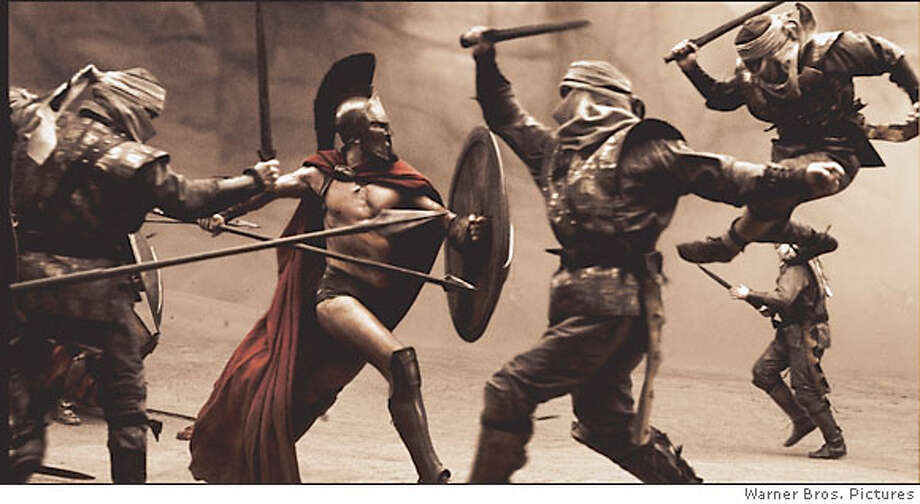 "Still from special effects movie ""300,"" based on frank miller's graphic novel. Leonidas (GERARD BUTLER) fights his way through the first wave of Persian infantry in Warner Bros. Pictures', Legendary Pictures' and Virtual Studios' action drama ""300,"" distributed by Warner Bros. Pictures.  PHOTOGRAPHS TO BE USED SOLELY FOR ADVERTISING, PROMOTION, PUBLICITY OR REVIEWS OF THIS SPECIFIC MOTION PICTURE AND TO REMAIN THE PROPERTY OF THE STUDIO. NOT FOR SALE OR REDISTRIBUTION  Leonidas (GERARD BUTLER) fights his way through the first wave of Persian infantry in Warner Bros. Pictures, Legendary Pictures and Virtual Studios action drama 300, distributed by Warner Bros. Pictures.  PHOTOGRAPHS TO BE USED SOLELY FOR ADVERTISING, PROMOTION, PUBLICITY OR REVIEWS OF THIS SPECIFIC MOTION PICTURE AND TO REMAIN THE PROPERTY OF THE STUDIO. NOT FOR SALE OR REDISTRIBUTION  Leonidas (GERARD BUTLER) fights his way through the first wave of Persian infantry in Warner Bros. Pictures', Legendary Pictures' and Virtual Studios' action drama ""300,"" distributed by Warner Bros. Pictures.  PHOTOGRAPHS TO BE USED SOLELY FOR ADVERTISING, PROMOTION, PUBLICITY OR REVIEWS OF THIS SPECIFIC MOTION PICTURE AND TO REMAIN THE PROPERTY OF THE STUDIO. NOT FOR SALE OR REDISTRIBUTION Photo: Ho Courtesy Of Warner Bros. Pict"