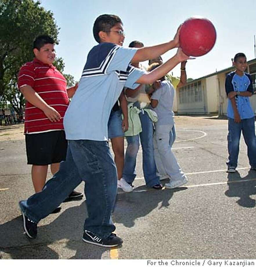 Robert Hinojoza, a 6th grader with asthma at Mayfair Elementary, plays four square during an unhealthy day Monday, Aug. 22, 2005 in Fresno, Calif. Photo by Gary Kazanjian/For the Chronicle Photo: Gary Kazanjian/For The Chronicle