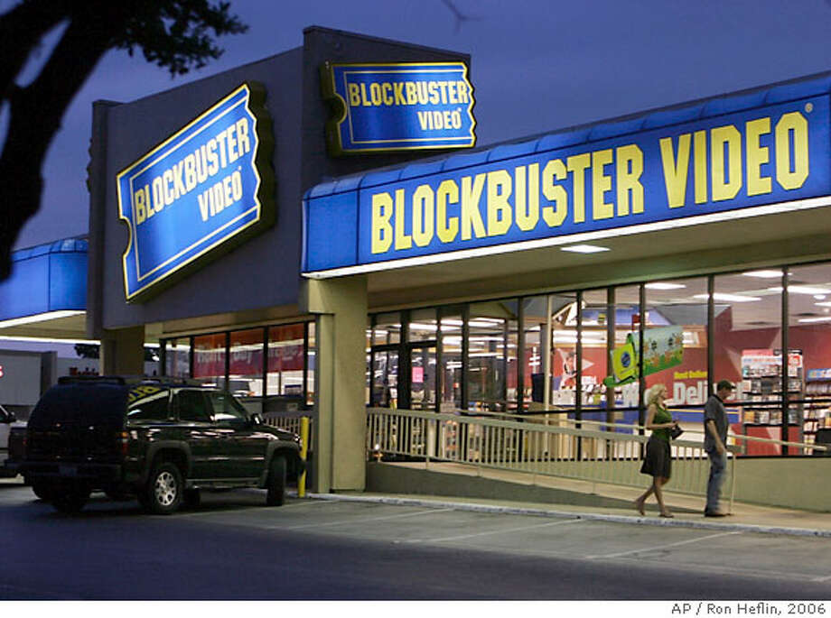 **FILE** Customers enter a Blockbuster video store in Dallas in this July 23, 2006 file photo. Movie rental company Blockbuster Inc. said Tuesday, Feb. 27, 2007 its fourth-quarter earnings declined 28 percent on increased operating costs. (AP Photo/Ron Heflin, file) Photo: RON HEFLIN