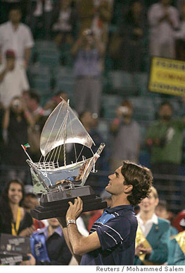 Switzerland's Roger Federer holds the trophy after winning the final match against Mikhail Youzhny of Russia at the Dubai Open tennis tournament March 3, 2007.REUTERS/Mohammed Salem (UNITED ARAB EMIRATES)  Ran on: 03-04-2007  Roger Federer overcame a surprising 2-0 deficit in the first set to win his 41st straight match and Dubai title.  Ran on: 03-04-2007  Roger Federer overcame a surprising 2-0 deficit in the first set to win his 41st straight match and Dubai title. Photo: MOHAMMED SALEM