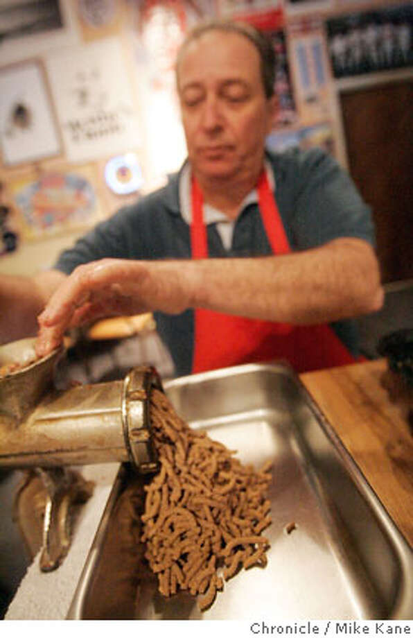 Jewish Deli Moishe's Pippic's owner Joe Sattler demonstrates the use of a hand-crank meat grinder as he works through some chopped liver in San Francisco, CA, on Thursday, February, 22, 2007. photo taken: 2/22/07 Mike Kane / The Chronicle ** Joe Sattler  Ran on: 03-04-2007  Joe Sattler, owner of Moishe's Pippic, makes chopped liver based on his mother's recipe: chicken livers only, a hand-crank grinder and just the right amount of schmalts. Photo: MIKE KANE