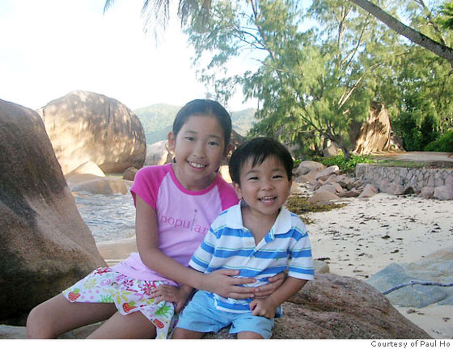 TRAVE JUSTBACK -- Paul Ho & family, Walnut Creek Email: dadapaul@hotmail.com  Daytime phone number: 925-938-8338 Just back from: The Seychelles Details of attached photo (if sent): The children, Kiki and Skip, enjoying a lazy afternoon on a granitic beach on Praslin Island, Seychelles. 12/20/06 in , . / Special to The Chronicle Photo: N/a