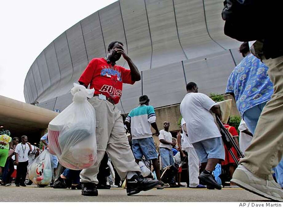 Residents file into the Louisiana Superdome in New Orleans on Sunday, Aug. 28, 2005. The Superdome opened Sunday to residents to New Orleans who are seeking shelter from Hurricane Katrina which is expected to make landfall on Monday. (AP Photo/Dave Martin) Photo: DAVE MARTIN