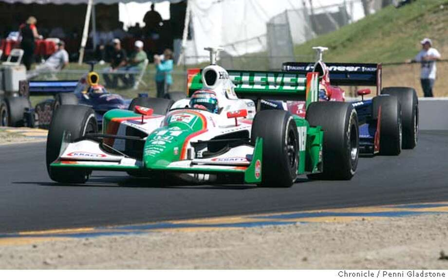 IRL_0705_PG.JPG tony Kanaan rounding a turn with another racer on his tail.  Argent Mortgage Indy Grand Prix, IRL race at Infineon Raceway. San Francisco Chronicle, Penni Gladstone  Photo taken on 8/28/05, in Sonoma, Photo: Penni Gladstone