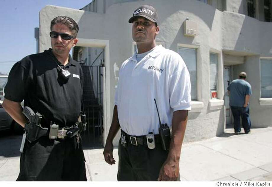 Angel Pasillas and Levi Williams, Armed security officers with HP Security, make sure everybody stays safe at The Health Center, a cannabis club, in San Leandro. 8/25/05 Mike Kepka / The Chronicle Photo: Mike Kepka