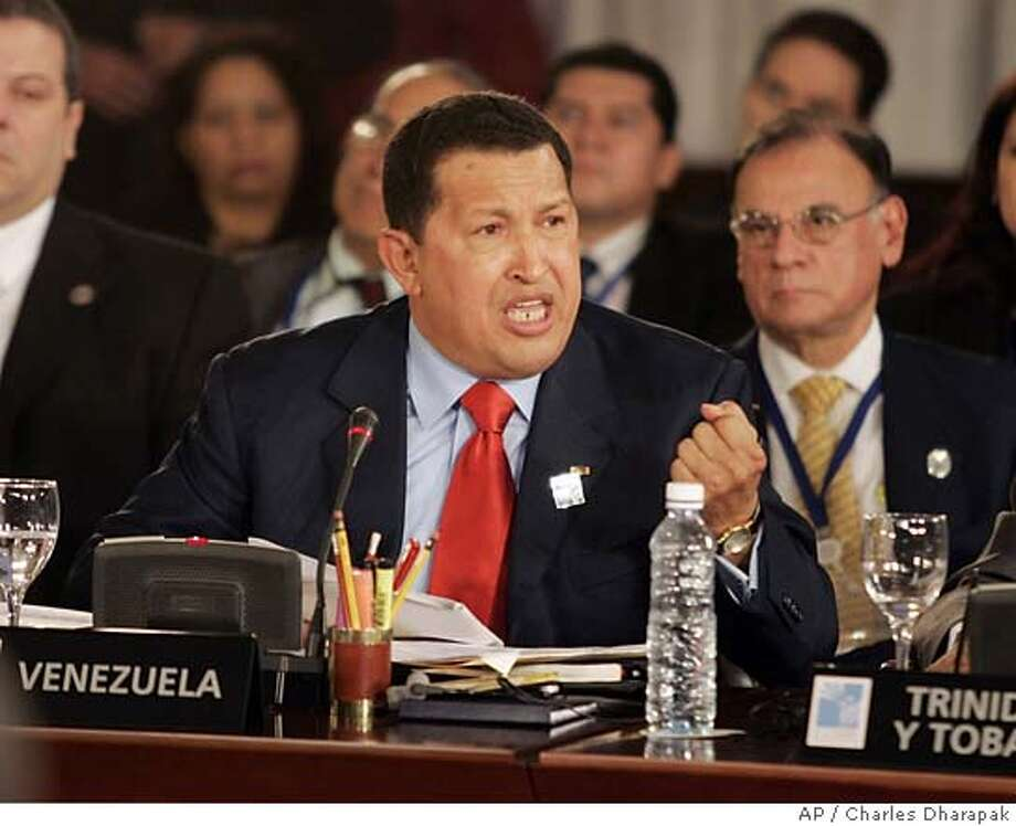 Venezuela's President Hugo Chavez addresses the first plenary session of the fourth Summit of the Americas at Mar del Plata, Argentina, Friday, Nov. 4, 2005. U.S. President Bush, not pictured, was also attending the session. (AP Photo/Charles Dharapak) Ran on: 11-05-2005  President Bush said he would be polite to Venezuela's president if he ran across him. Ran on: 11-05-2005  President Bush said he would be polite to Venezuela's president if he ran across him. Photo: CHARLES DHARAPAK