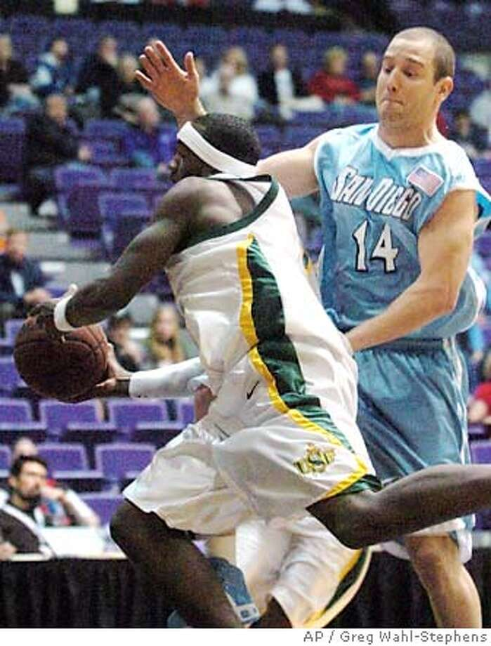 San Diego's Ross DeRogatis (14) defends against San Francisco's Antonio Kellogg (5) during West Coast Conference tournament college basketball in Portland, Ore., saturday March 3, 2007. San Diego beat San Francisco, 77-75. (AP Photo/Greg Wahl-Stephens) Photo: Greg Wahl-Stephens